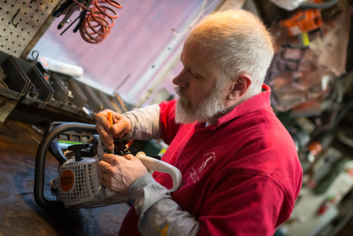Allan Working on a Chainsaw | by goingslowly