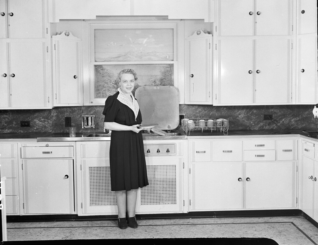 Woman in kitchen, 1939 | Item 18545, City Light Photographic… | Flickr