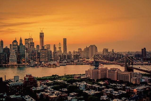 New York City Skyline Sunset And The Brooklyn Bridge On A