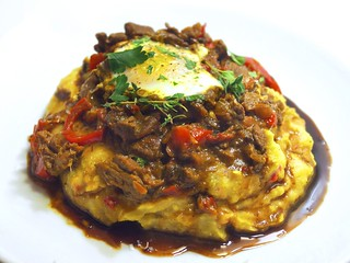 polenta with a beef and pepper ragu, an egg, and a balsamic reduction | by andy pucko