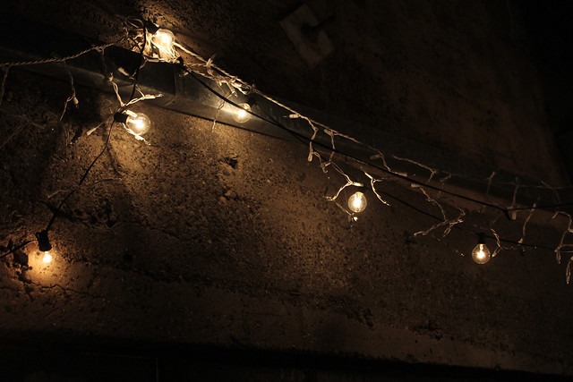 white string lighting hanging on cement wall, angle Flickr - Photo Sharing!