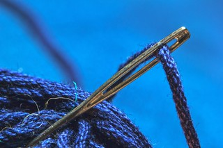 sewing needle with thread | by Markus Grossalber