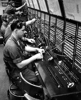 Soldiers from the 69th Signal Battalion man the switchboards in Saigon. They handle more than 26,000 calls a day | by manhhai