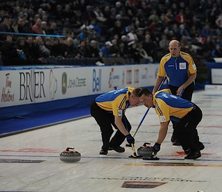 Edmonton Ab.Mar4,2013.Tim Hortons Brier.Alberta skip Kevin Martin,second Marc Kennedy,lead Ben Hebert.CCA/michael burns photo | by seasonofchampions