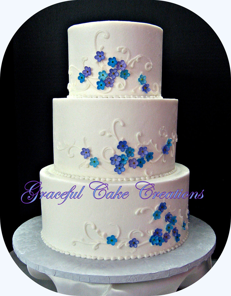 White buttercream wedding cake with purple and blue flower flickr white buttercream wedding cake with purple and blue flowers by graceful cake creations izmirmasajfo Images