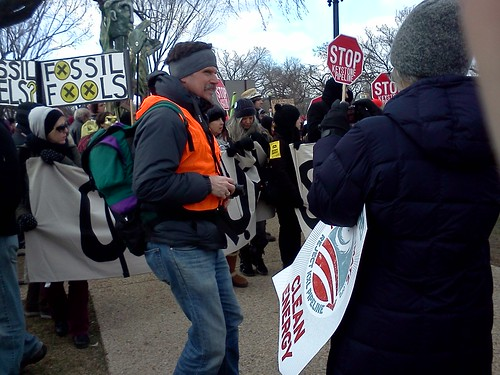 Occupy unrolling their #nokxl banner and holding end fossil fuels signs #forwardonclimate | by 350mass