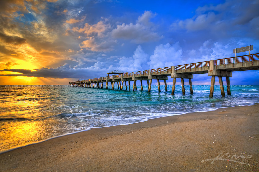 Juno beach fishing pier during a stormy sunrise over atlan for Juno fishing report