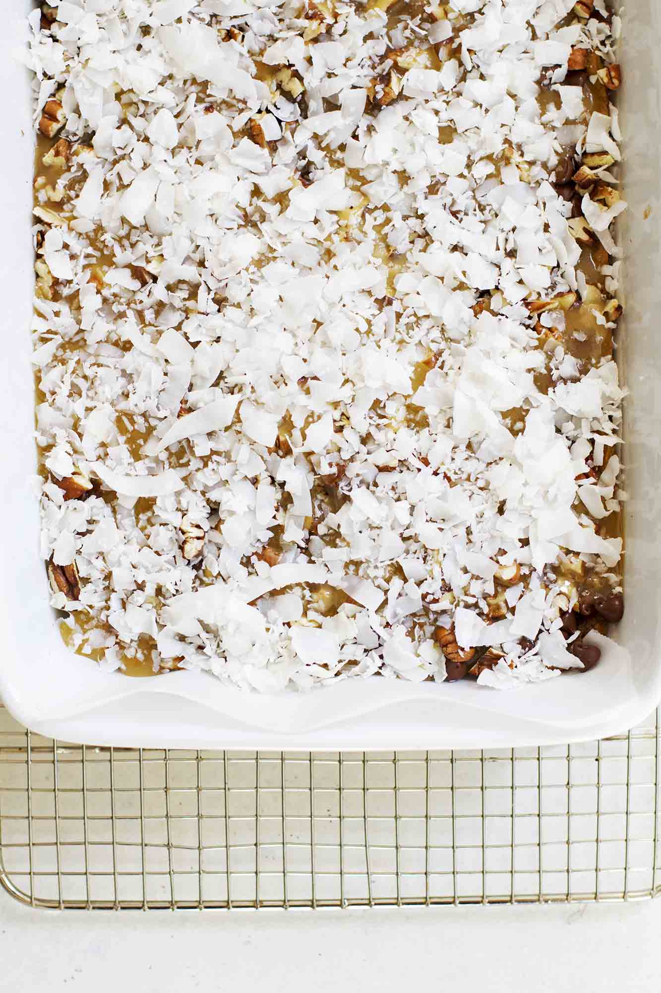 Caramel Coconut Chocolate Chip Bars | girlversusdough.com @girlversusdough