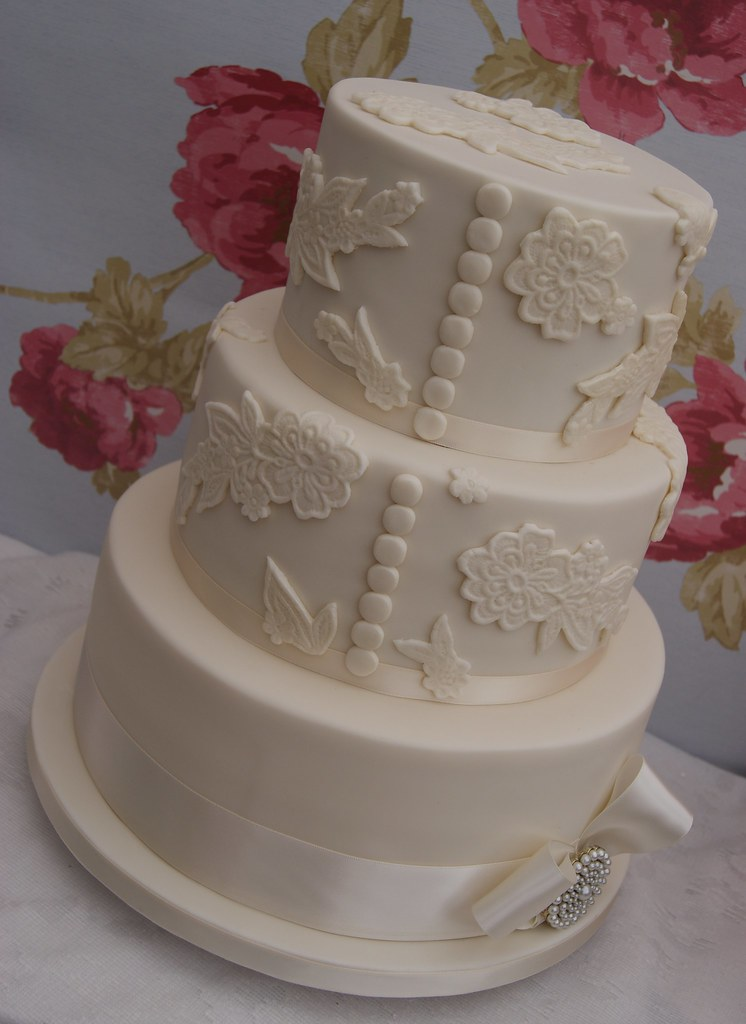 Lace, buttons and bow Wedding Cake