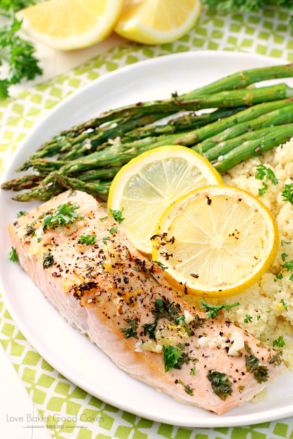 Sheet Pan Lemon, Garlic & Herb Salmon with Asparagus on a white plate.