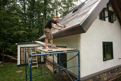 Tyler Affixing First Course of Slate to Strawbale Cottage Roof | by goingslowly