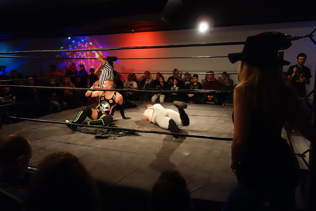 Raymi the Ring Girl watching wrestlers at Hogtown Wrestling