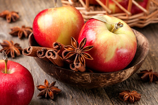 Apples with spices on a wooden background | by derrickbrutel