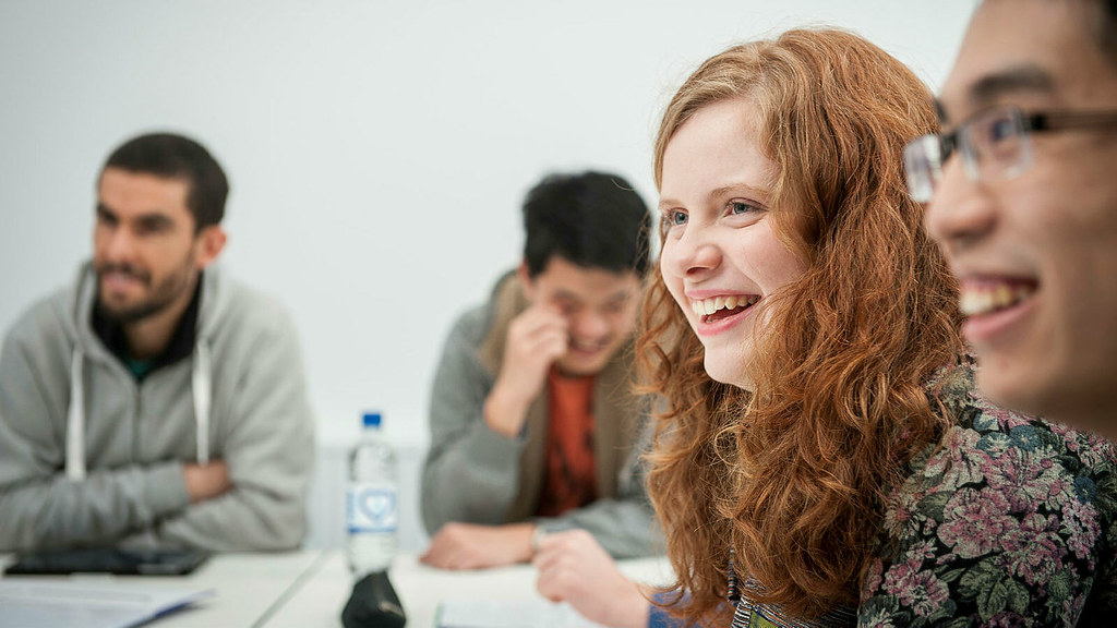 Students in a classroom smiling and laughing
