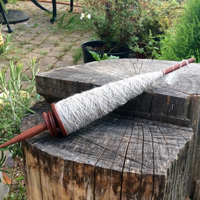 Handspun Corriedale wool on captive ring Peruvian Pushka spindle