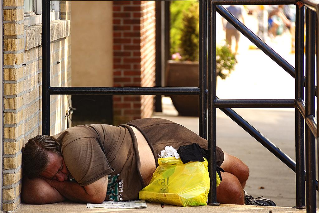Large man sleeping near Le Viet on 11th Street--Bella Vista