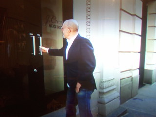 Mickey Drexler trying to open a door | by Wyscan