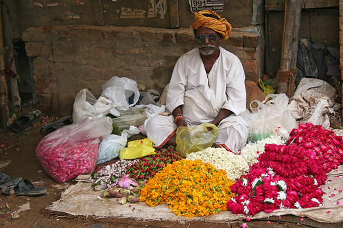 Indian Hindu man selling flowers at the Ganges in Varanasi, India. | by cookiesound