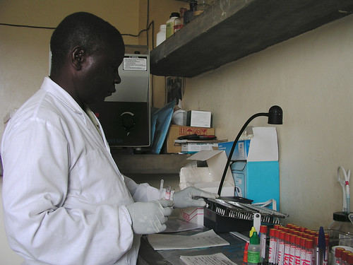 A laboratory technician conducts an HIV test | by World Bank Photo Collection