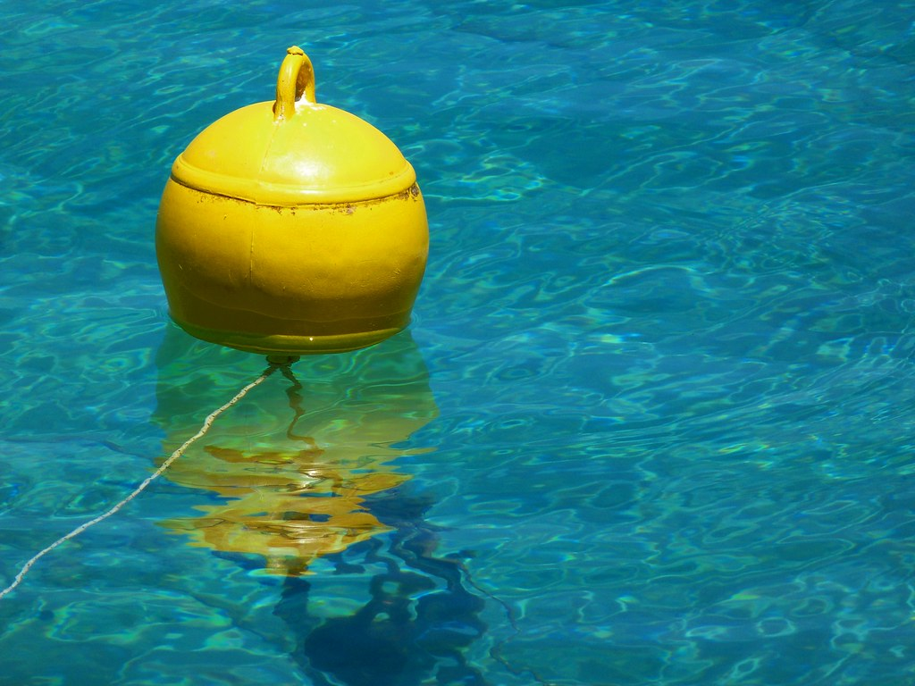 Yellow buoy   Yellow buoy reflected in the blue sea water