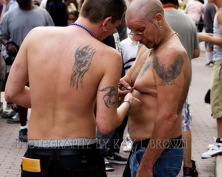 Pulling the nipple rings | Rosa Parks Circle, Grand Rapids