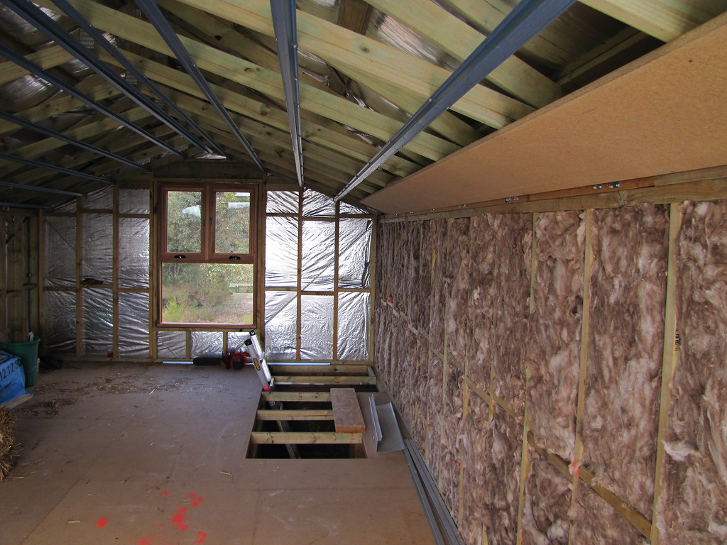 Attic window and insulation strawbale house build in red for New home insulation