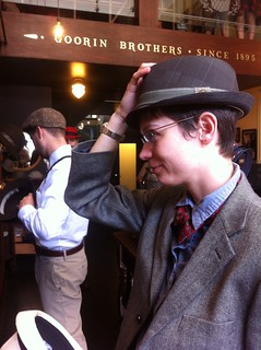 Laura tries on a fancy hat at Goorin Bros Hat Shop in North Beach | by colinaut