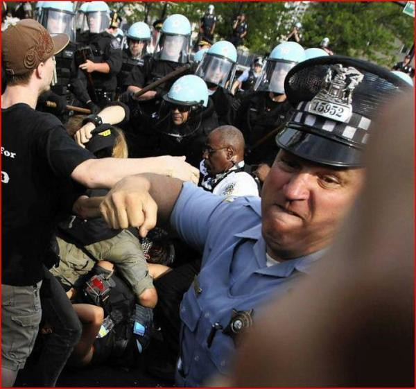 Chicago NATO Cop throwing punch Brian Cassella, Chicago Tribune