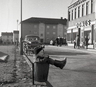 Boy resting in trash can in Gothenburg 1961 | by Stockholm Transport Museum Commons