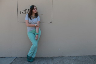 "Green with envy outfit: turquoise moccasins, mint green BDG jeans from Urban Outfitters, heather gray v-neck pocket t-shirt from Gap, Marc by Marc Jacobs sunglasses, ""Sparkled Agate Bib Necklace"" from Anthropologie, etc. 