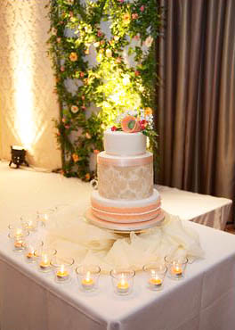 peach and white wedding cake and white wedding cake set up at the beautiful 18136