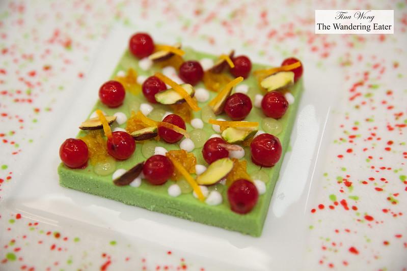 Iced pistachio, kumquat, red curants in juice with Kirsch