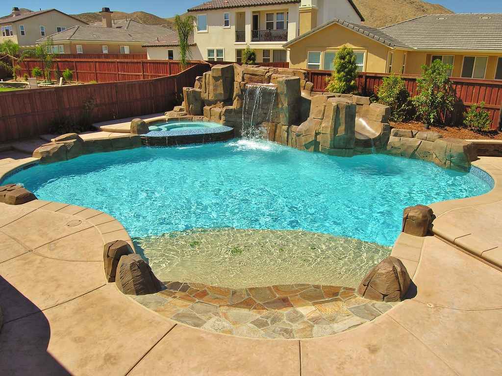 Custom pool spa combo with beach entry rock waterfall a flickr Beach entry swimming pool designs