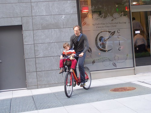 Bike share bicycle with child in the carrier