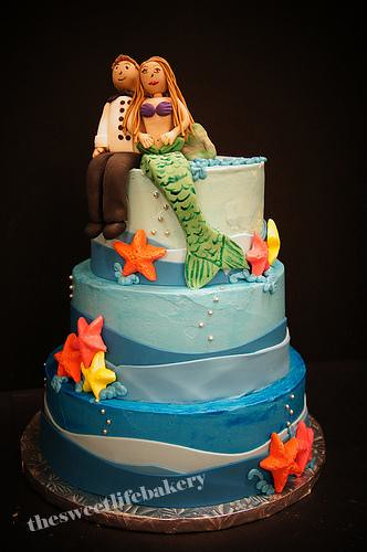 sea life wedding cake toppers chef and mermaid wedding cake a sea themed three tier 19709