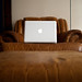 Macbook on antique couch