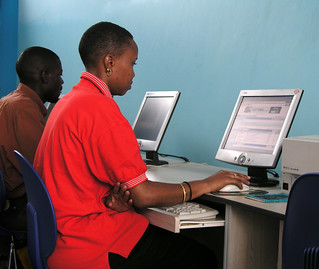Woman uses a computer in an internet cafe | by World Bank Photo Collection