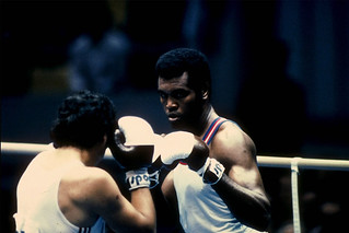 Teofilo Stevenson of Cuba (right) focuses intently on his opponent during a heavy weight bout in the 1980 Summer Olympic Games held in Moscow, USSR. ©ROH/2012 | by Royal Opera House Covent Garden