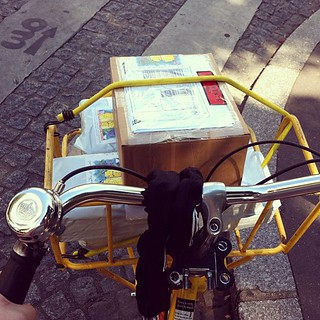 I love riding my La Poste #bike to drop off packages at the post office. I always get smiles when people see me in the bike with the basket full of packages. #velo #paris #loisivethe | by PutYourFlareOn