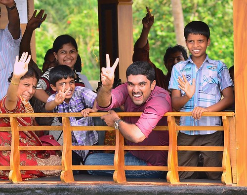 """Hello you guys"" - Happy travellers on a houseboat in the Alleppey Backwaters, Kerala. 