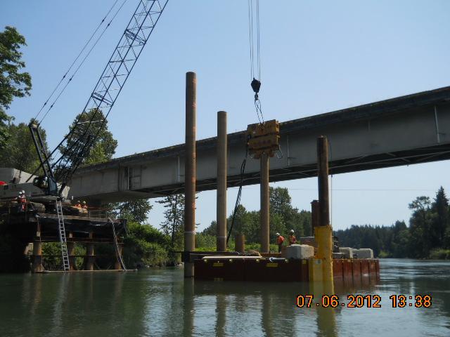 Snohomish River bridge widening | Crews drill piles in the r