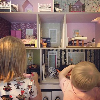 The dollhouse is being invaded by lizards and a dinosaur. | by Nicole Balch