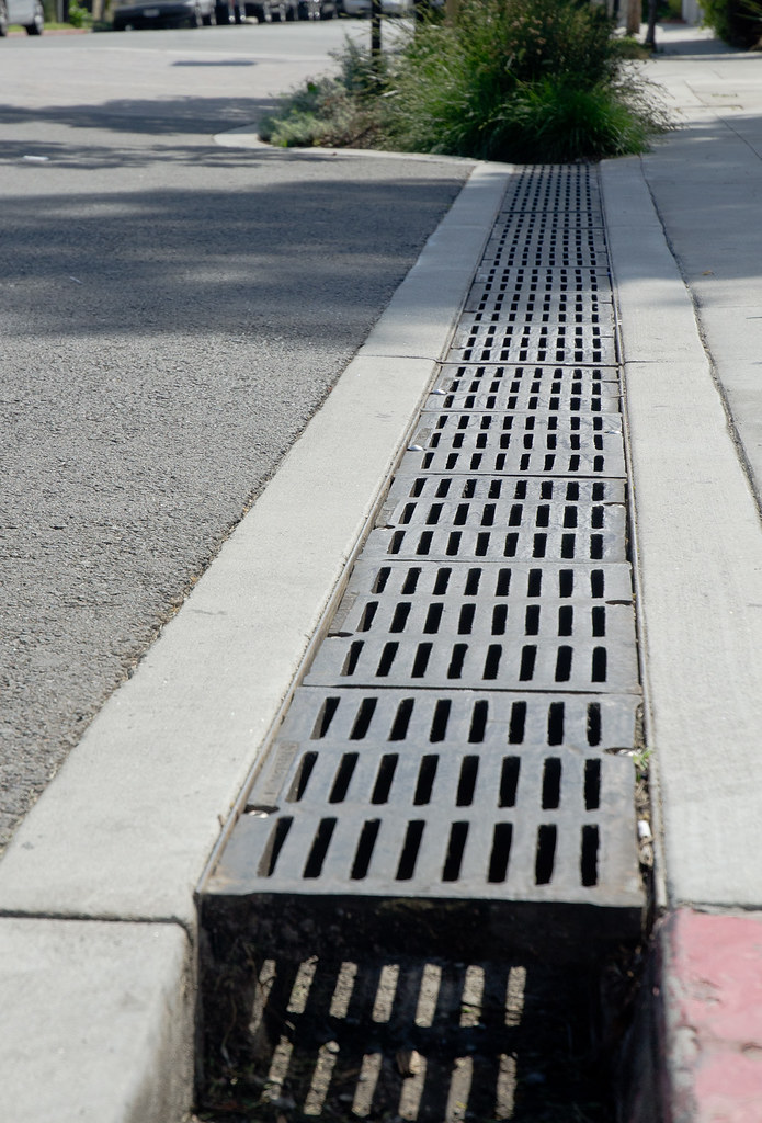 Flush Pavement Bridge over Gutter - Steel grating bridges th ...