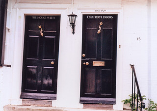 the house with two front doors | by Millie Clinton.