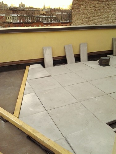 Laying down of paver pedestals and patio pavers by New York Plantings | by NewYorkPlantings