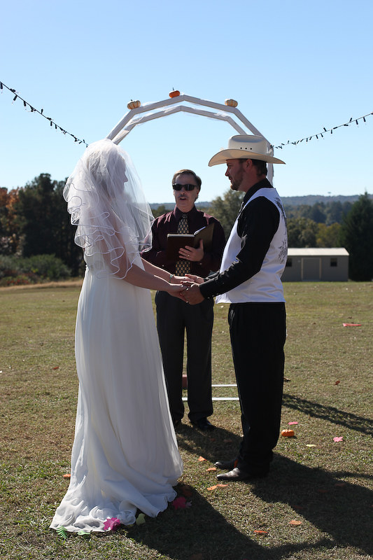 WEDDING OFFICIANT STONE MOUNTAIN PARK RODEO COWBOY BRIDE AND GROOM SAY I DO