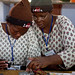 Women work together on solar lighting circuit boards