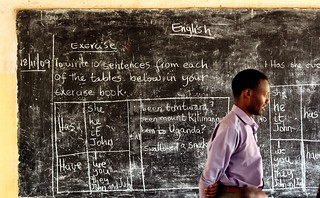 School teacher standing at the blackboard. | by Community Eye Health