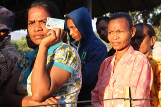 07.07. 2012. A woman holds her voter registration card whilst waiting to vote in Timor-Leste's 2012 Parliamentary Elections. | by United Nations Development Programme