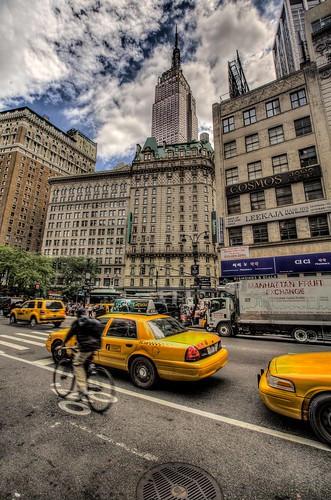 cyclist by the empire state | by Paul Cowell
